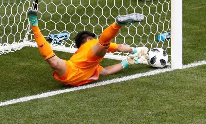 Eiji Kawashima parries the ball over the line after the colombia free kick.jpg